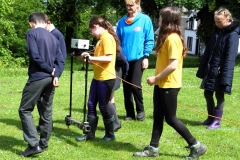 peta-glew-supervises-pupils-carrying-out-geophys-at-the-orry-eaglesham